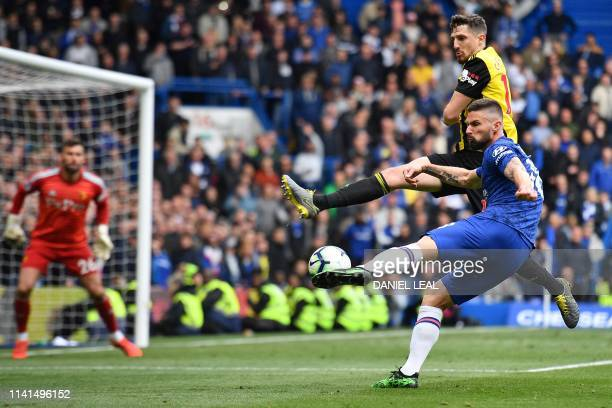 Chelsea's French striker Olivier Giroud shoots but fails to score during the English Premier League football match between Chelsea and Watford at...