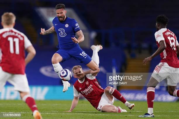 Chelsea's French striker Olivier Giroud vies with Arsenal's English defender Rob Holding during the English Premier League football match between...