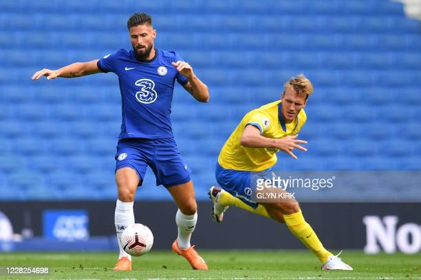 Chelsea's French striker Olivier Giroud vies with Brighton's English defender Dan Burn during the pre-season friendly football match between Brighton...