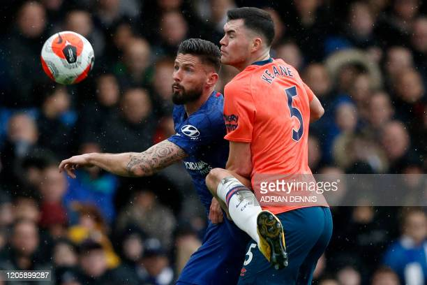 Chelsea's French striker Olivier Giroud vies with Everton's English defender Michael Keane during the English Premier League football match between...