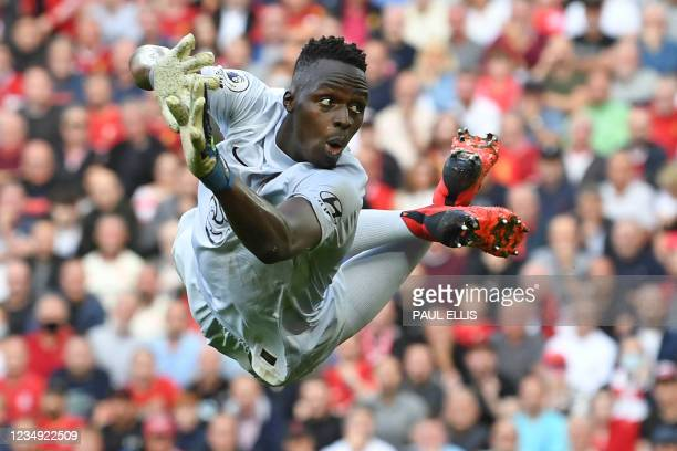 Chelsea's French-born Senegalese goalkeeper Edouard Mendy dives during the English Premier League football match between Liverpool and Chelsea at...