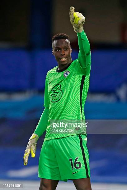 Chelsea's French-born Senegalese goalkeeper Edouard Mendy gestures during the English Premier League football match between Chelsea and Manchester...