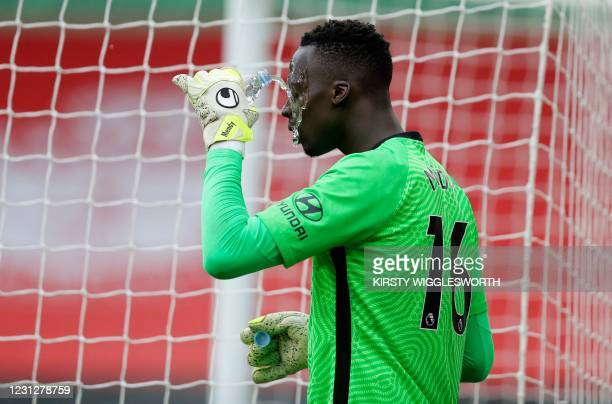 Chelsea's French-born Senegalese goalkeeper Edouard Mendy has a drink during the English Premier League football match between Southampton and...