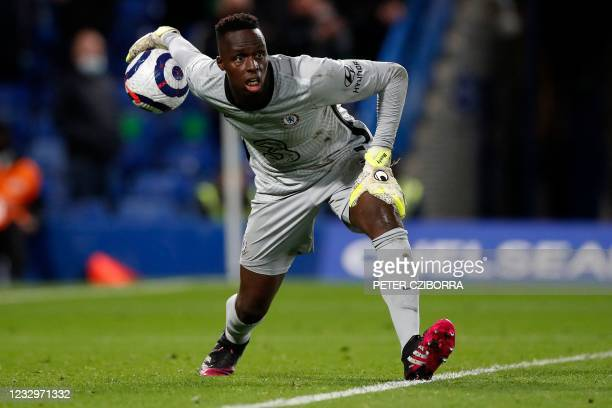 Chelsea's French-born Senegalese goalkeeper Edouard Mendy rols the ball out during the English Premier League football match between Chelsea and...