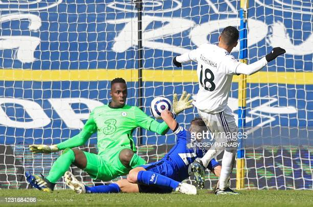 Chelsea's French-born Senegalese goalkeeper Edouard Mendy saves a shot from Leeds United's Brazilian midfielder Raphinha Dias Belloli during the...