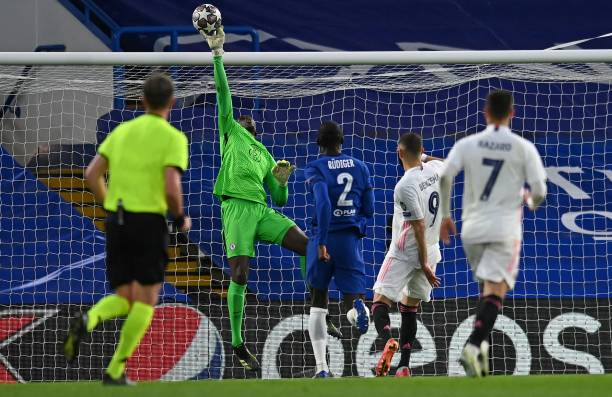 Chelsea's French-born Senegalese goalkeeper Edouard Mendy saves a shot from Real Madrid's French forward Karim Benzema during the UEFA Champions...