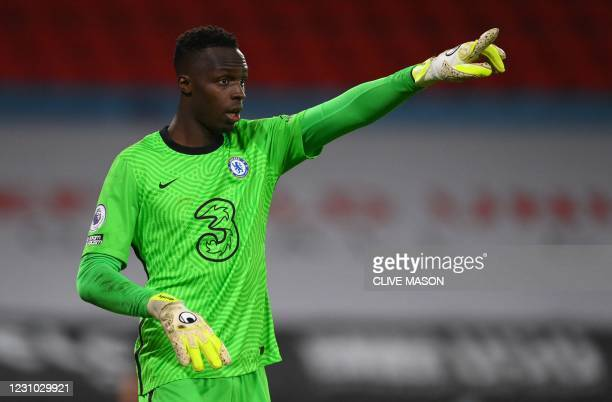 Chelsea's French-born Senegalese goalkeeper Edouard Mendy signals to his teammates during the English Premier League football match between Sheffield...