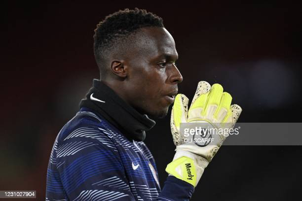 Chelsea's French-born Senegalese goalkeeper Edouard Mendy warms up ahead of the English Premier League football match between Sheffield United and...