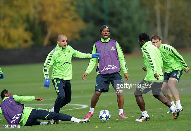 Chelsea's from left John Obi Mikel Alex Didier Drogba and Michael Essien take part in a team training session at the club's training facility in...
