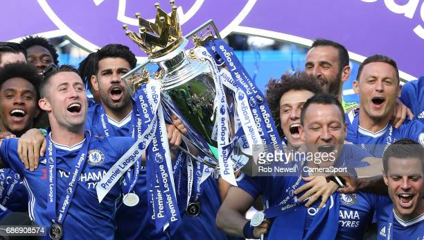 Chelsea's Gary Cahill and John Terry lift the trophy during the Premier League match between Chelsea and Sunderland at Stamford Bridge on May 21 2017...