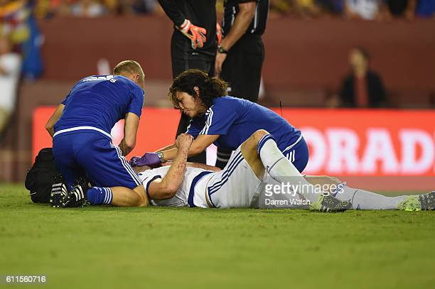 Chelsea's Gary Cahill lays injured after scoring the equaliser and is treated by Dr Eva Carneiro and Jon Fearn during a Pre Season Friendly match...