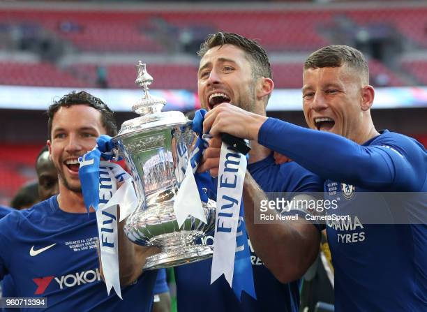 Chelsea's Gary Cahill Ross Barkley and Danny Drinkwater with the trophy during the Emirates FA Cup Final match between Chelsea and Manchester United...