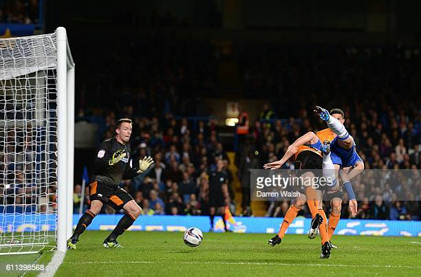 Chelsea's Gary Cahill scores the opening goal of the game