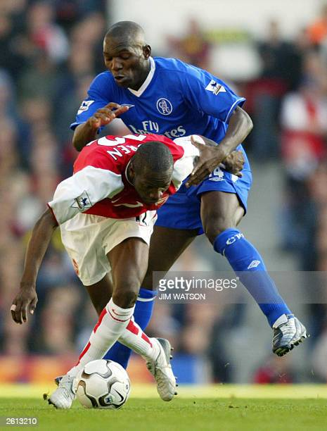 Chelsea's Geremi vies for the ball with Arsenal's Lauren at Highbury Stadium in London 18 October 2003 Arsenal beat Chelsea 21 after a game winning...