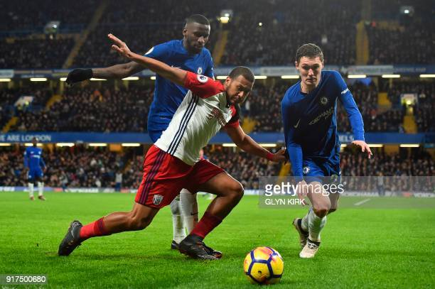Chelsea's German defender Antonio Rudiger and Chelsea's Danish defender Andreas Christensen try to shut down West Bromwich Albion's Venezuelan...