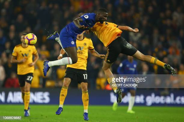 Chelsea's German defender Antonio Rudiger and Wolverhampton Wanderers' Mexican striker Raul Jimenez go up for a high ball during the English Premier...