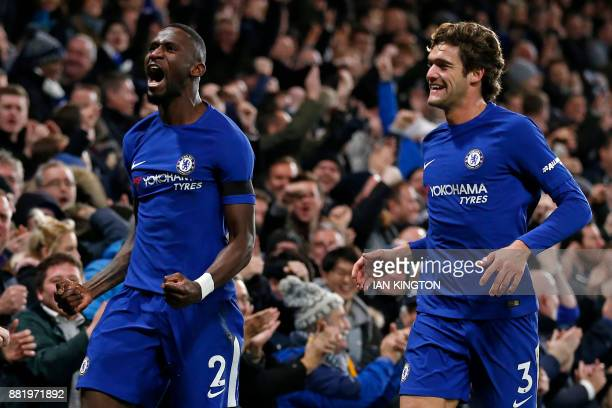 Chelsea's German defender Antonio Rudiger celebrates with Chelsea's Spanish defender Marcos Alonso after scoring the opening goal of the English...