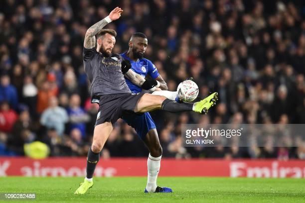 Chelsea's German defender Antonio Rudiger challenges Sheffield Wednesday's Scottish striker Steven Fletcher during the English FA Cup fourth round...