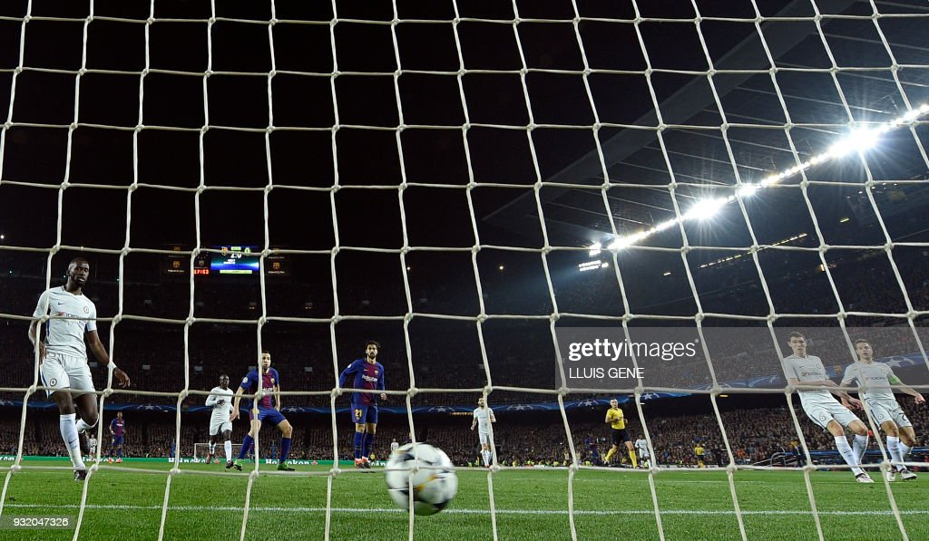 Chelsea's German defender Antonio Rudiger (L), Chelsea's Danish defender Andreas Christensen and Chelsea's Spanish defender Cesar Azpilicueta (R) react as Barcelona score their third goal during the UEFA Champions League round of sixteen second leg football match between FC Barcelona and Chelsea FC at the Camp Nou stadium in Barcelona on March 14, 2018. /