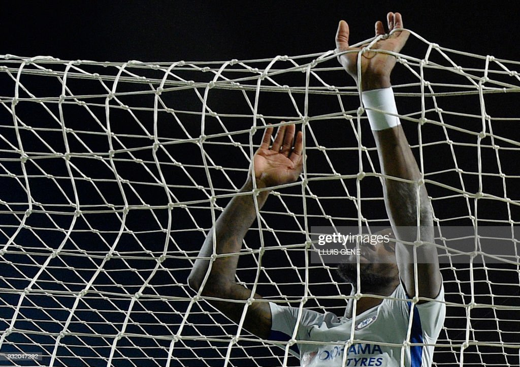Chelsea's German defender Antonio Rudiger reacts to Barcelona's third goal during the UEFA Champions League round of sixteen second leg football match between FC Barcelona and Chelsea FC at the Camp Nou stadium in Barcelona on March 14, 2018. /