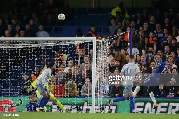 Chelsea's German defender Antonio Rudiger scores from a looping header during the English League Cup fourth round football match between Chelsea and...