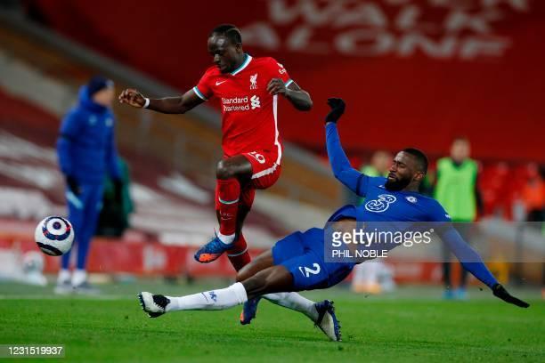 Chelsea's German defender Antonio Rudiger tackles Liverpool's Senegalese striker Sadio Mane during the English Premier League football match between...