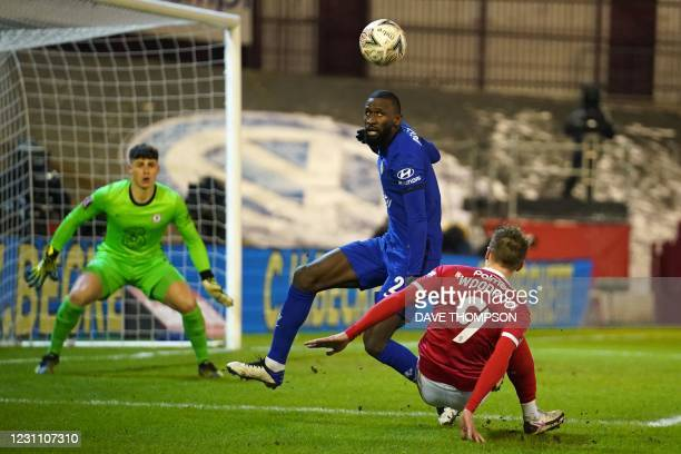 Chelsea's German defender Antonio Rudiger vies with Barnsley's English striker Cauley Woodrow during the English FA Cup fifth round football match...