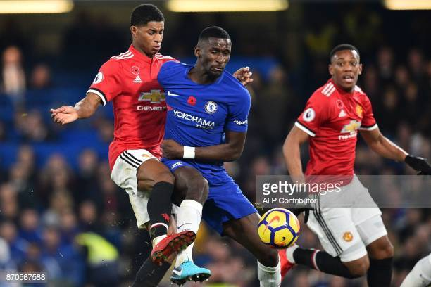 Chelsea's German defender Antonio Rudiger vies with Manchester United's English striker Marcus Rashford during the English Premier League football...