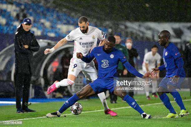 Chelsea's German defender Antonio Ruediger challenges Real Madrid's French forward Karim Benzema during the UEFA Champions League semi-final first...