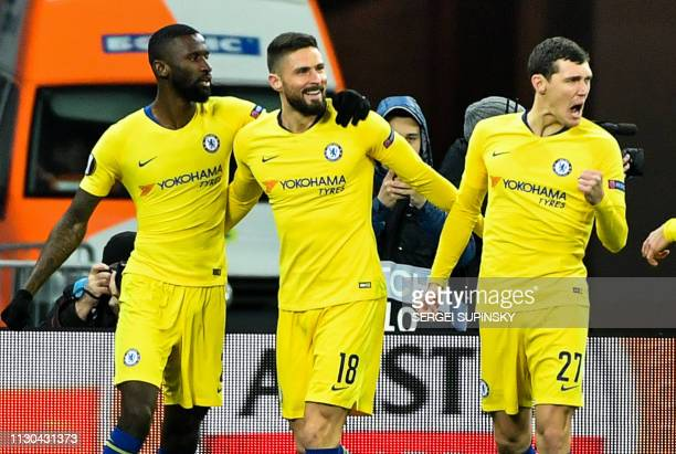 Chelsea's German defender Antonio Ruediger Chelsea's French forward Olivier Giroud and Chelsea's Danish defender Andreas Christensen celebrate after...