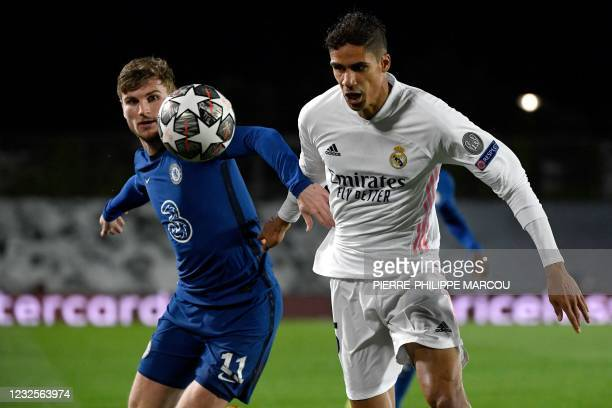 Chelsea's German forward Timo Werner vies with Real Madrid's French defender Raphael Varane during the UEFA Champions League semi-final first leg...