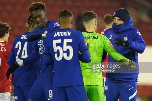 Chelsea's German head coach Thomas Tuchel congratulates Chelsea's Spanish goalkeeper Kepa Arrizabalaga on the pitch after the English FA Cup fifth...