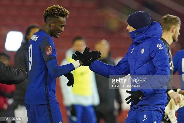 Chelsea's German head coach Thomas Tuchel congratulates Chelsea's English striker Tammy Abraham after the English FA Cup fifth round football match...