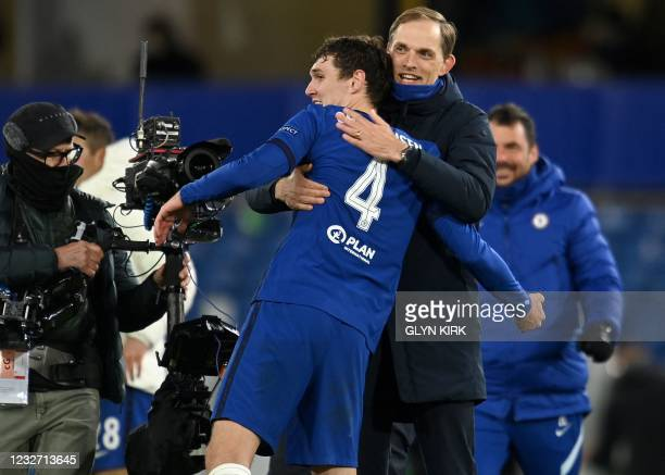 Chelsea's German head coach Thomas Tuchel congratulates Chelsea's Danish defender Andreas Christensen after the UEFA Champions League second leg...