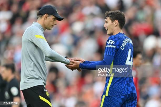 Chelsea's German head coach Thomas Tuchel congratulates Chelsea's Danish defender Andreas Christensen after the English Premier League football match...