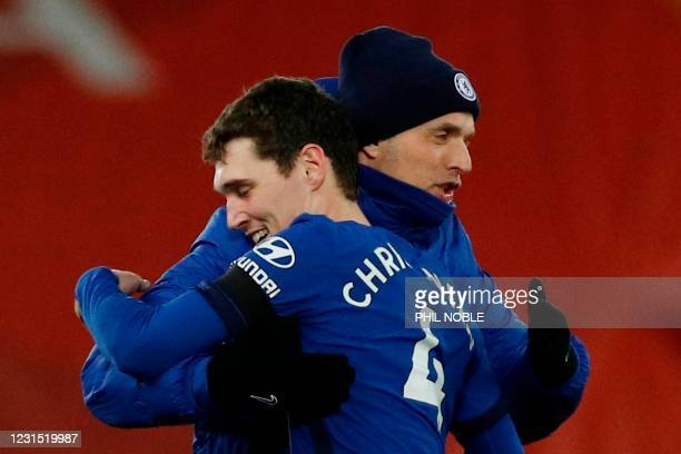 Chelsea's German head coach Thomas Tuchel embraces Chelsea's Danish defender Andreas Christensen at the end of the English Premier League football...