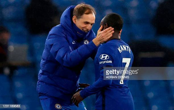 Chelsea's German head coach Thomas Tuchel embraces Chelsea's French midfielder N'Golo Kante after the English Premier League football match between...