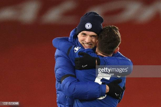 Chelsea's German head coach Thomas Tuchel embraces Chelsea's Italian midfielder Jorginho at the end of the English Premier League football match...