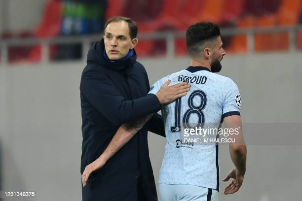 Chelsea's German head coach Thomas Tuchel greets Chelsea's French striker Olivier Giroud during the UEFA Champions League round of 16 first leg...