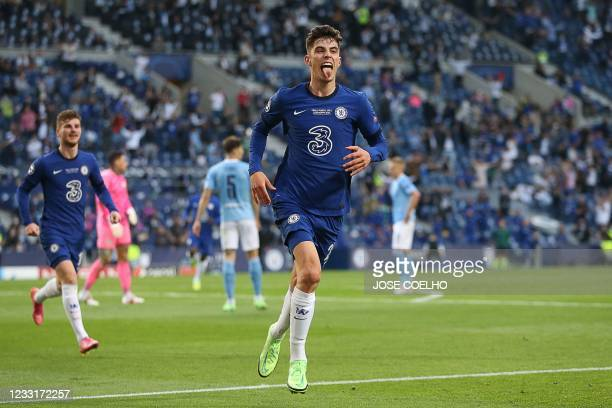 Chelsea's German midfielder Kai Havertz celebrates after scoring his team's first goal during the UEFA Champions League final football match between...
