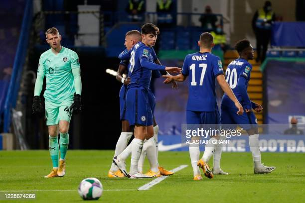 Chelsea's German midfielder Kai Havertz celebrates teammates after scoring his team's fourth goal during the English League Cup third round football...