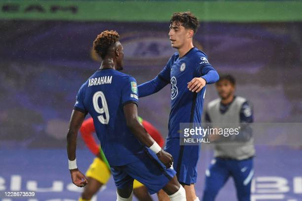 Chelsea's German midfielder Kai Havertz celebrates with Chelsea's English striker Tammy Abraham after scoring his team's second goal during the...