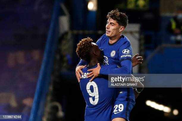 Chelsea's German midfielder Kai Havertz celebrates with Chelsea's English striker Tammy Abraham after scoring his team's fourth goal during the...