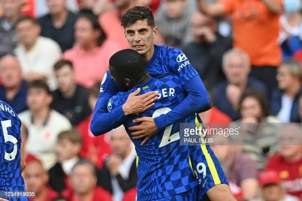 Chelsea's German midfielder Kai Havertz celebrates with Chelsea's German defender Antonio Rudiger after scoring the opening goal of the English...