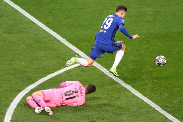 Chelsea's German midfielder Kai Havertz jumps over Manchester City's Brazilian goalkeeper Ederson to score the first goal during the UEFA Champions...
