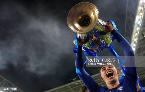 Chelsea's German midfielder Kai Havertz lifts the Champions League trophy after Chelsea won the UEFA Champions League final football match between...