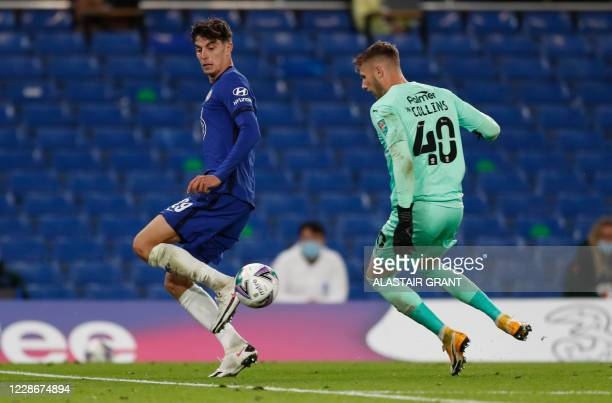 Chelsea's German midfielder Kai Havertz runs past Barnsley's English goalkeeper Brad Collins to score his team's fifth goal during the English League...