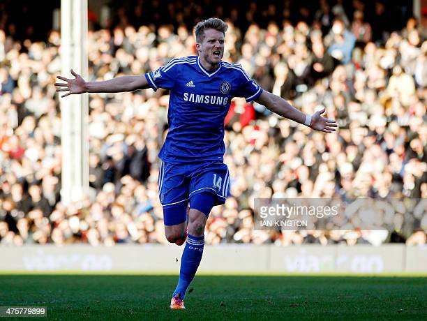 Chelsea's German striker Andre Schurrle celebrates scoring the opening goal during the English Premier League football match between Fulham and...