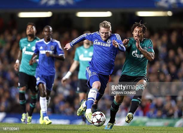 Chelsea's German striker Andre Schurrle vies for the ball against Schalke's US midfielder Jermaine Jones during the UEFA Champions League group E...