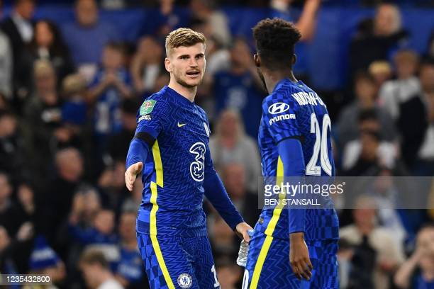 Chelsea's German striker Timo Werner and Chelsea's English midfielder Callum Hudson-Odoi react after the penalty shoot-out during the English League...